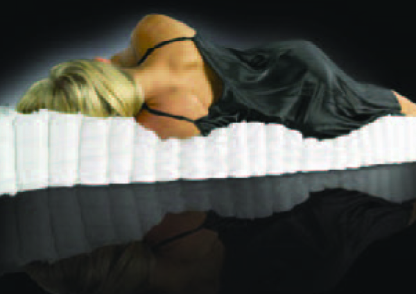 woman laying on pocketed coils